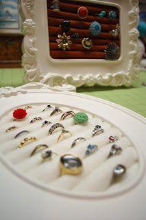 DIY ring holder - rolled felt hot glued together and onto cardboard inserted into picture frame.