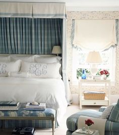 White bedding with monograms with patterned skirt