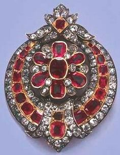 AN ANTIQUE RUBY AND DIAMOND PENDANT BROOCH The central cushion-cut ruby and diamond floral cluster centre within a ruby and diamond graduated crescent, mounted in silver and gold, circa 1870, 4.5 cm. high