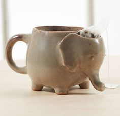 A chubby elephant mug that has a little head pocket for your tea bag. | 38 Of The Cutest Animal-Themed Products You've Ever Seen