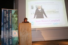 Marilyn Turkovich of the Charter for Compassion presenting Lifetime Achievement Award to Joan Brown Campbell