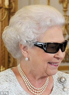 Queen Elizabeth II in her 3D glasses, which have a glittering Swarovski 'Q' on the side