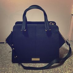 Zac Zac Posen Shoulder bag  Make an offer!! Zac Zac Posen Saffiano leather structured black shoulder bag.  Measures W - 11.5 in (at base), H - 9.5 in, D - 6 in.  New with tags attached and comes with dust bag.  Dust bag has small tear on the side, but the handbag is in perfect condition!  Only selling because it was an impulse buy and I have other bags I love more than this one. Zac Posen Bags Shoulder Bags
