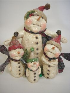 These sweet snow folks measure 3 1/2 to 7 1/2 inches high and are made from a papier mache/sawdust mixture. They have been painted, stained