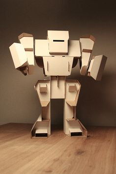 I want one. I really want one. <41″ standing robot maquette, made of cardboard.