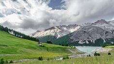 of Alps in Cancano Lake, Valtellina by FerradalFCG Wide angle view time lapse of idylic alps with houses near Cancano lake in Valtellina, 4k