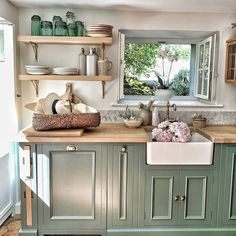 Colorful cabinets wood countertops and a farmhouse sink yep its our ki Green Kitchen Cabinets, Wood Cabinets, New Kitchen, Kitchen Dining, Kitchen Decor, Cottage Kitchen Sinks, Kitchen With Wood Countertops, Country Countertops, Kitchen Paint