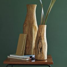 "Log Vases   ""Each mango wood vase makes a striking statement displaying branches, dried flowers, or on their own."""
