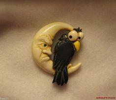 carved Bakelite  Bone Black Bird on Man in Moon Button