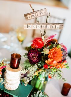 scrabble pieces incorporated into centerpiece & table #'s