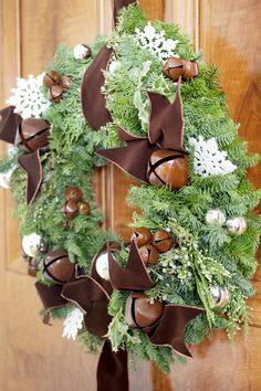 Lovely wreath with bells. #wreaths http://www.aftershocksinteriordecorating.com