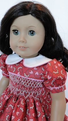 Here is a very lovely hand-smocked Valentine dress from Cyria of dancingwithneedles. What a joy to add one of her superb smocks to my Valentine collection. Thank you for such a really pretty dress with gorgeous colors and smocking, Cyria.