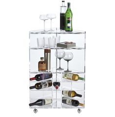 SAIC Tonic bar cart ($599), cb2.com  Home decor holiday gift ideas, room to room holiday gift guide, dining room gifts, bar cart