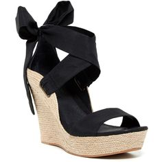 """Sizing: True to size.;Open toe;Crisscross strap with back bow detail;Wedge heel;Approx.  5"""""""" heel, 1"""""""" platform;Imported"""