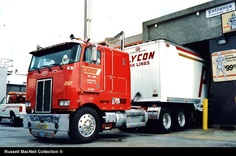 A big Pete for Huntington, NY based Plycon Van Lines with a custom built Dorsey furniture trailer in the service bay of the former Courtesy House 76 Auto Truck Stop W. of Vero Beach, FL in the early 90's. The big chromed front bumper looks neat with the Plycon name etched into it.  (Photo: http://www.hankstruckpictures.com/macneil_90s_13.htm)