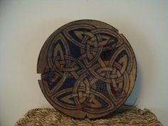 Small hand turned dish which has been pyrographed with Celtic designs.