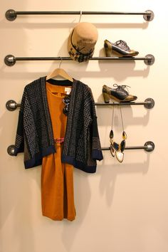 interesting idea for a walk-in closet as a way to put together a whole outfit or prep it for the next day.