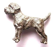 Border Terrier brooch pin made from finest pewter & gift-boxed. The pin has the authentication stamp of the US manufacturer on the reverse. Price includes gift box, VAT & UK postage.