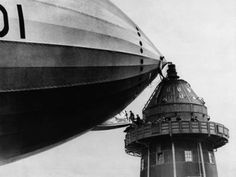 R-100 Airship at Mooring Mast. Can you imagine passengers embarking/disembarking at the top of the Empire State Building in standard windy conditions?