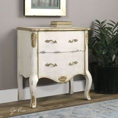 Turn your guestroom into a royal suite with our Donosa Aged White Accent Chest.