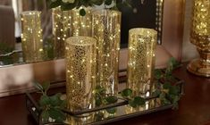 Anniversary Centerpieces, Valerie Parr Hill, Living Room Decor Inspiration, Fireplace Mantle, Mercury Glass, Hurricane Glass, Dining Room Table, String Lights, Night Light