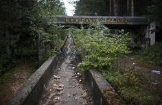 The disused bobsleigh track from the Sarajevo 1984 Winter Olympics is seen on Mount Trebevic, near Sarajevo. Abandoned and left to crumble into oblivion, most of the 1984 Winter Olympic venues in Bosnia's capital Sarajevo have been reduced to rubble. 1984 Winter Olympics, 1984 Olympics, Bobsleigh, Abandoned Buildings, Abandoned Places, Abandoned Mansions, Places Around The World, Around The Worlds, Olympic Venues