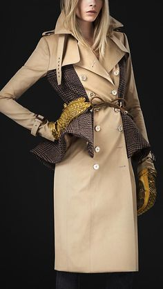 Burberry Prorsum. Crisp cotton trench coat with wool check panels Structured shoulders, nipped-in waist and exaggerated peplum detail