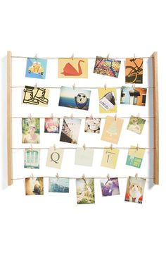 Free shipping and returns on UMBRA 'Hangit' Photo Display at Nordstrom.com. Show off up to 40 favorite snapshots, postcards and pieces of art with a country-chic clothesline display.