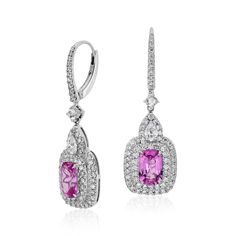 Cushion Cut Pink Sapphire and Diamond Halo Earrings in 18k White Gold from Blue Nile.  Extraordinary color is captured in these gemstone and diamond earrings, showcasing vibrant pink sapphires framed by a scintillating double halo of pav diamonds set in 18k white gold.