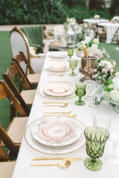 We love this natural color palette with gorgeous green goblets, mix matched china, and gold flatware.