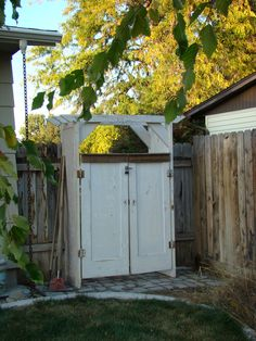 I built this garden gate from four old doors.  I'm anxious to finish up everything on both sides and add some plantings!