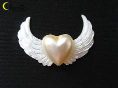 White Heart Mabe on Mother of Pearl Wings 30x47mm