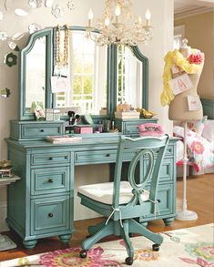 Really cute vanity...Love Love This color, shape, the drawers,,,Just need a com chair and great lighting