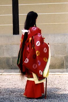 A woman dressed in traveling junihitoe for a historical parade.Japan