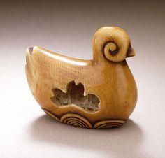 virtual-artifacts:  Stylized Swimming Duck, second half of 19th century Masanobu (Adachi Tomoshichi) (Japan, born 1838) Netsuke, Ivory with staining, sumi. LACMA
