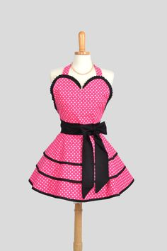 Sexy Retro Pin Up Apron : Handmade Cute and Sexy Ruffled Pink with Small White Dots and Black Kona Trimmed. $50.00, via Etsy.
