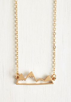 Slip on this sweet gold necklace - which dangles a snow-topped mountain range pendant from a delicate cable chain - and let your imagination climb up to the highest heights.