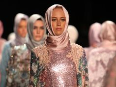 A Muslim fashion designer has made history as the first ever designer tofeature hijabs in every outfit on a New York Fashion Week catwalk. Indonesian designer Anniesa Hasibuan, 30, delighted crowds with her Spring Summer '17 collection D'Jakarta. Models wore flowing trousers and skirts in silk, lace and chiffon in an array of pastel colours. One stand-out garment included an intricate gold lace dress, featuring metallic embroidery at the bustand a fringed lace train.