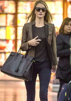 Rosie Huntington-Whiteley carrying the black Sac de Jour tote by Saint Laurent when arriving at LA airport.