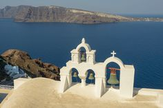 Oia Santorini Greece church bells. You would have lots of churches if you lived on an active volcano too.