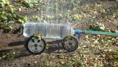 A DIY Rolling Sprinkler! recycling plastic bottles: creative and clever with plastic bottles - crafts ideas - Pop Bottles, Plastic Bottles, Water Bottles, Water Jugs, Plastic Pop, Recycled Bottles, Homemade Sprinkler, Garden Projects, Garden Tools
