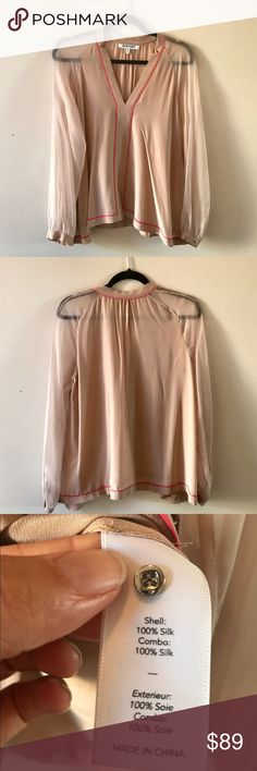 Elizabeth & James 100% silk baby doll top XS Sold out ✨ Baby doll Sheer sleeve 100% silk top with coral piping and v neck silhouette. Button sleeve with spare button included. Stunning on! Take it from work to special occasion.  Wore to work over the course of a year . No snags . Good condition! Elizabeth and James Tops