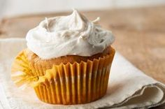Pumpkin Cupcakes with Cinnamon-Cream Cheese Frosting recipe - What could make a moist pumpkin cupcake better? Cream cheese frosting spiced with cinnamon, of course!