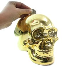 Putting coins in the Gold Skull Money Box Make Money From Home, Make Money Online, How To Make Money, Money Bank, Pocket Money, Gold Skull, Piggy Bank, Cool Stuff, Stuff To Buy