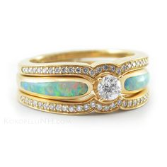 LOVE the Gold, would prefer a white opal over a green opal.....Diamond and Opal Engagement Ring with 2 Wedding Bands