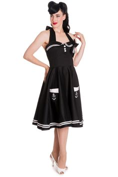 This is a awesome, adorable yet sexy sailor dress which is made of heavy stretch cotton with white sailor stripes to the hem and top. It features a removable bow, two pockets in front with anchor and