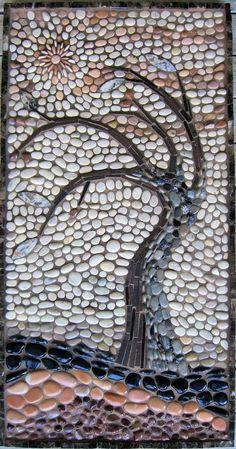 rock mosiac of a leafless tree