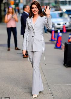 Busy babe: Anne Hathaway donned a powerful grey pantsuit while heading to the set of The L. Anne Hathaway Style, Star Fashion, Suits For Women, Celebrity Style, Celebrity Babies, Designer Dresses, Nice Dresses, Beautiful People, Lace Up