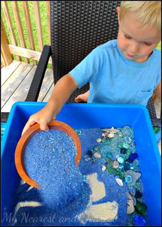 Ocean sensory bin with mirrors at the bottom - fun kids sensory activity