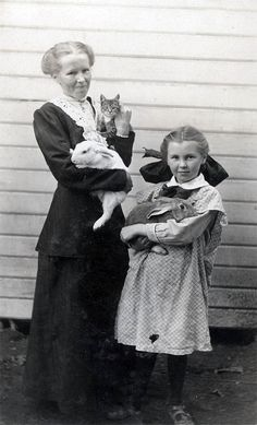Mother Holds Cat Bunny Rabbit Little Girl w Bunny by maclancy